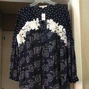 Navy blue top with crochet flowers